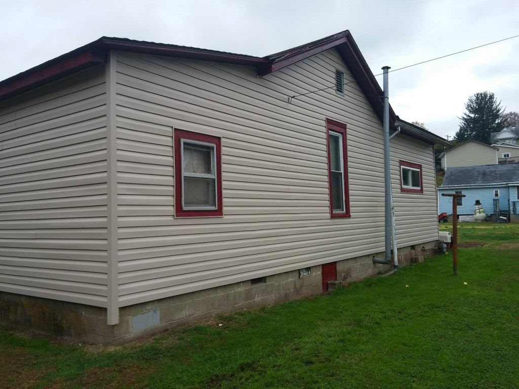 Vinyl siding and insulation were added to the outside of Erica & James's house.