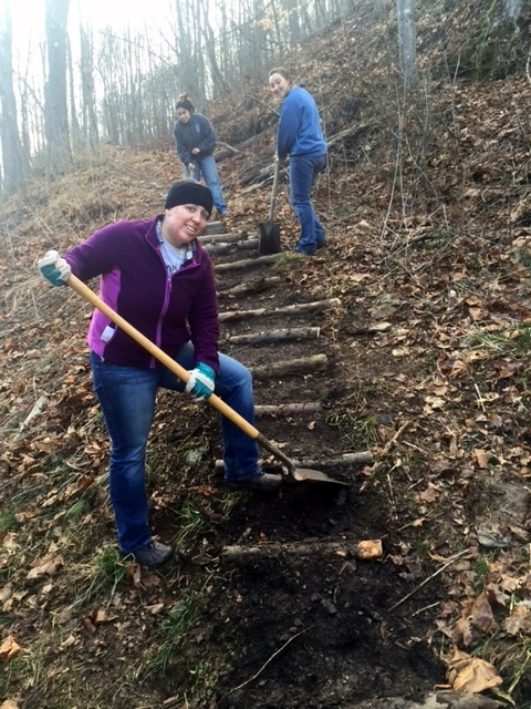 Volunteers build terraced steps to prevent soil erosion on our trails.